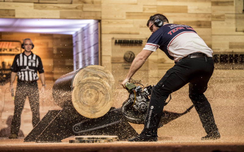 Matthew Cogar of the United States performs in the Hot Saw discipline during the finals of the Stihl Timbersports World Championships at the Porsche-Arena in Stuttgart, Germany on November 12, 2016.