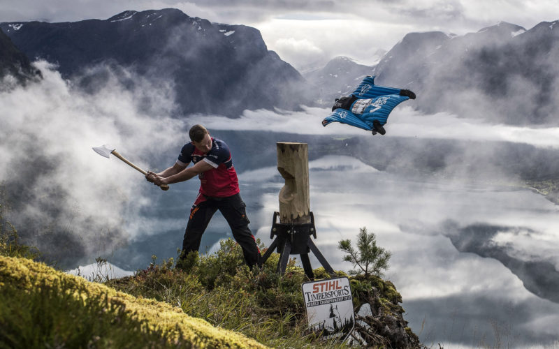 """Picture shows Norway's Timbersports athlete Vebjørn Bleka Sønsteby and Wingsuit ace Espen Fadnes during an encounter between the world's """"oldest extreme sports"""" and one of its newest in the mountains near Stryn in western Norway on 11-September 2017 to announce the upcoming """"Stihl Timbersport World Championship"""" to be held in Lillehammer on November 3-4."""